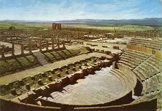Timgad, Algeria.  Created as a military colony by Roman Emperor Trajan in 100 AD.  An excellent example of Roman town planning.