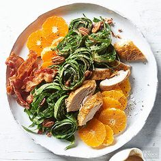 A healthy salad for a cold winter day. Pecan & Collard Chicken Salad Salad with Maple Dijon Dressing.