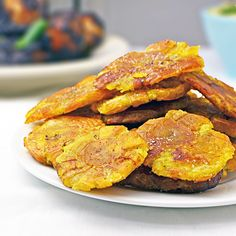 Tostones are delicious, addictive, and ridiculously easy to make. Fried green plantains