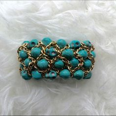 Turquoise & Gold skull bracelet Discounted Bundles ▪️Please use the offer feature  ▪️Ships within 24 hours ✈️ ▪️No tradesNo Paypal ▪️ Love the item but not the price?  Make an offer!  ▪️Questions?  Don't be shy!  Feel free to ask  ▪️Condition - NWOT ▪️Description - Gorgeous turquoise colored skull and gold colored chain bracelet.  Stretches to adjust most wrists.  The skulls have beautiful detail and can be rotated to your liking. Jewelry Bracelets