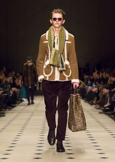 A classic brown shearling jacket layered with an embroidered scarf