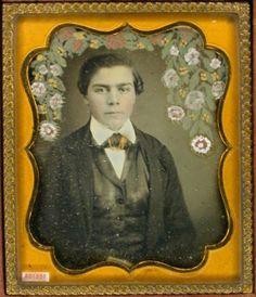 ca. 1850's, [daguerreotype portrait of a gentleman with flowers painted on plate in wreath motif over his head] via the Daguerreian So...