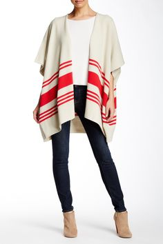 Stray from the ordinary in a soft and cozy open-front cardigan. Dropped shoulders and a long hemline create an oversize cocoon shape sure to make this piece a statement through the seasons.