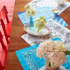 Dress up your picnic table this Independence Day with a runner of neatly pressed bandanas.