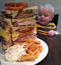 Gigantwich: The giant sandwich is built around six thick slices of bread and is crowned with three extra large onion rings. On the side, there is a large portion of chips and a huge pile of coleslaw