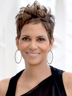 Sheared, Tapered, and Long On Top Halle Berry has been rocking this haircut for as long as we can remember, so it for sure has staying power. Its length on top adds volume, while its shorn sides allow the focus to stay on your face. Spring Hairstyles, Pixie Hairstyles, Pixie Haircut, Short Hairstyles For Women, Halle Berry Hairstyles, Black Hairstyles, Weave Hairstyles, Halle Berry Short Hair, Short Sassy Hair
