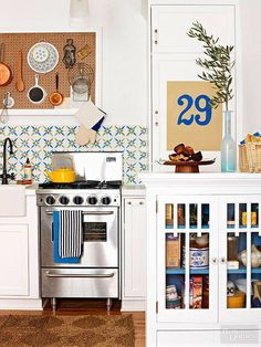 Frustrated with your tiny kitchen? These tips can help you learn to love your small space! There& something special about compact kitchens, especially because they use less energy. For more on tiny kitchen organization, head to Domino! Quirky Kitchen, Compact Kitchen, New Kitchen, Vintage Kitchen, Kitchen Decor, Kitchen Ideas, Whimsical Kitchen, Space Kitchen, Kitchen Country