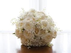 glorious white roses, jasmine and lily of the valley.wedding flower bouquet, bridal bouquet, wedding flowers, add pic source on comment and we will update it. www.myfloweraffair.com can create this beautiful wedding flower look.
