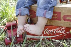 Brandy Caruso Photography. Denver CO Child photographer.  Spring Vintage Mini Session.  Vintage photo props. Boy in field, coke crates, coke bottles, vintage theme