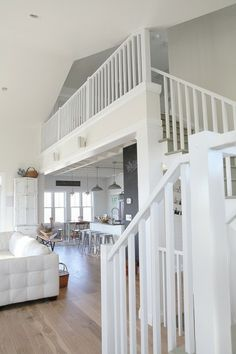 Julie Ranee family home : love these white stairs and tall ceilings
