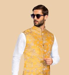A honey yellow Nehru jacket with golden threadwork embroidery !! #floral #nehrujacket #groomwear #designer #style #fashion #men #modern #indianweddings #indiawear #latest