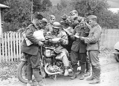 The dispatch rider with his Puch 350 GS stops to deliver intel with a group of military personnel.