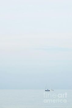 Two boats sail on the horizon of the Adriatic Sea on a cloudy day
