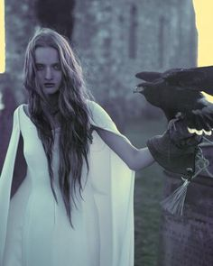 white dress, long hair, falcon. yes.