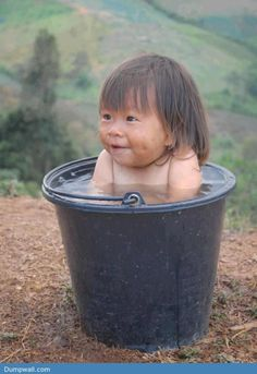Just a happy kid in a bucket - http://dumpwall.com/?p=2772