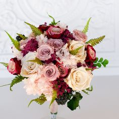 All real preserved flowers that look and feel just like fresh but will last for years! A bridal bouquet with an abundance of roses in colors that matches all the 2017 bridesmaids trends. Marsala , Mos