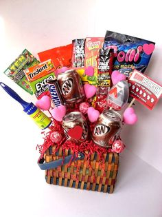 Valentines Day gift for him. I used skewers/dowels and hot glued candy, beefy jerky, lottery tickets and fun little things to them. Then stuck the dowels into a foam ball inside a basket. And wha la!