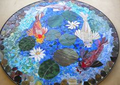 ABOUT THIS ITEM:     MADE TO ORDER koi mosaic tabletop SIZE: 30 dia. tabletop (base NOT included)      Hand cut stained glass mosaic created on