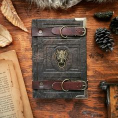 Handmade Leather Journals of Mille Cuirs. Mille Cuirs is an illustrator, graphic designer, sculptor, and artist from Quebec, Canada. Continue reading and for more leather journal →View Website Leather Art, Leather Gifts, Leather Books, Handmade Leather, Leather Tooling, Leather Jewelry, Custom Leather, Leather Book Binding, Leather Texture