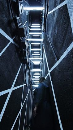 LIGHT PASSAGE is located in the narrowest alley of Chungjangro. It allows visitors to travel to another space, not through virtual portals but through their actual movement. Opening the door, visitors meet LED lines inspired by silk threads installed as if they are weaving buildings together. They guide them to the public parking lot and sometimes detect and follow visitors' movements. -Gwangju Biennale