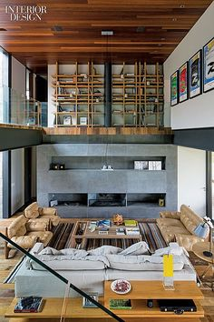 City and Country: Grass Roof Conceals Rio Vacation House | Sergio Rodrigues's pair of chairs and sofa face each other in the living area.
