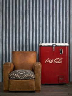 how 'bout corrugated steel wallpaper? this is *palmer*....in iron......by andrew martin....