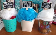 """Prizes for baby shower games- mini buckets filled with loofa, body wash, lip balm, and body lotion. """"From our shower to yours!"""""""