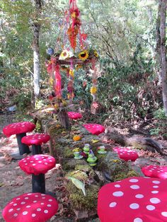 Woodland Fairy theme table .. The mushroom chairs are so clever! and the chandelier is fab.