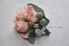 Grooms Designer Buttonhole with mini blush pink roses, brunia and I would use Dusty Miller at the back (Silver/Grey Leaves)