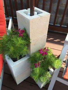 "Cinderblock umbrella stand (painted or plain)  Add plants to beautify!  umbrella stand tower"" Consisting of 2 regular cinder blocks and 3 half-sized ones (I didn't know they existed!) with the umbrella suspended in white marble stones that were poured down the empty 'chute' of the stacked blocks."