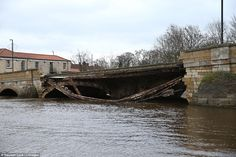 Devastating: The entire 300-year-old bridge in Tadcaster, North Yorkshire, fell into the s...
