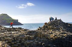 Giants Causeway is old, having recently celebrated its 60 millionth birthday (give or take a few millennia). Bordered by the North Atlantic Ocean and a landscape of dramatic, barren cliffs, this natural feature is steeped in legend.