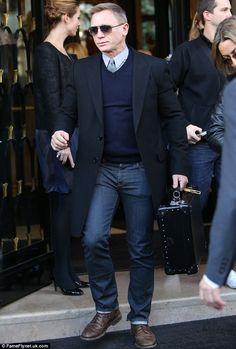 Not shaken or stirred: Daniel Craig looks as cool as fictional British spy James Bond as he leaves the Georges V hotel in Paris on Thursday