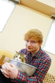 It's a cat ... in a bowl ... in Ed's arms. #perfection