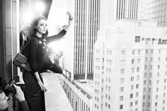 """Miss Dior, Fall 2012 -- waving to her """"people"""" (no one has """"people"""" in New York) or hailing a cab from the 35th floor?"""