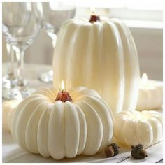White pumpkins light up the room for Halloween.