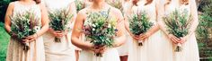 Simple bouquets of Heather, lavender chamomile, feverfew, delphinium, solidago and herbs for a carefree wildflower look wedding. Photo by Megan McAllister.