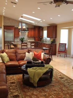 Family Room inspiration:  shows colored pillows w/ rug similar to the one from the Pottery Barn - the green & coral accents look great with the brown sofa