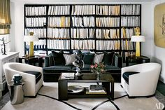 In an art-filled London townhouse decorated by François Catroux, what appears to be bookshelves is actually a wall-size painting by Khalil Rabah.