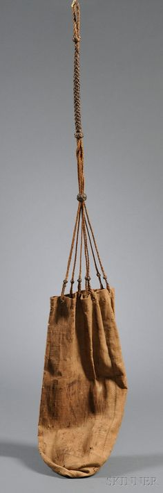 Sailor's Ditty Bag, America, 18th century, heavy hand sewn linen bag with braided hemp strap, length of bag approximately 20 in. Skinner Auctioneers & Appraisers of Objects with Value