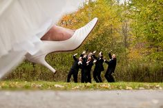 Funny shot with the bride 'stepping' on the groomsmen. Surely they did something to deserve this :p | Credit: Micah Bowerbank Photography