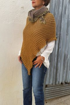 Womens poncho, mustard knitwear, wrap poncho, knit mustard poncho.  Mustard is very trendy this year but for me is a classical must have, I really love this dark mustard color and this poncho is a classical trend that I wanted to knit. Soft, ethereal and warm this wraponcho is the perfect casual and boho wear this fall/winter season. Youll love wearing it.  Hand loose knitted in a mixture of 50% merino, 25% alpaca and acrilyc  Size. 8/10 UK. 4/6 US 36/38 EU  Made to order, please allow me 10…