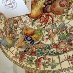 Mosaic from broken crockery - but so much nicer than the usual random ones!