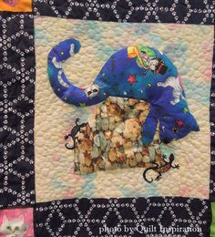 """close up, """"Inquisitive Fat Cats"""" by Ann Scrivener.  Design by Janet King (Kime?).  2014 Tucson Quilters' Guild show, photo by Quilt Inspiration"""