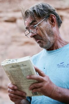Driver TP delving into one of the many great reads in our Cataract Canyon Library box.