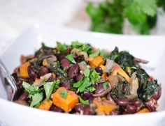 http://foodfitnessfreshair.com/2012/11/25/black-beans-with-roasted-sweet-potatoes-and-kale/
