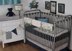 Banner with map print, chevrons and herringbone blue  fabrics made by Back at the Pond Designs.  Bedding by Pine Creek Bedding.  Aqua  and navy in the nursery.