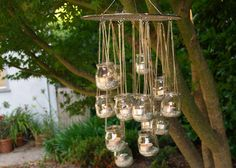 "-*+Spotted over on DIY Weddings, this DIY project is easy, affordable, and eco-friendly!  Plus, it is a great budget-friendly way to add ""chandeliers"" to your wedding decor.  And you can hang them in your garden after your day has passed. Go to Michelle Kaufman's blog for full instructions."