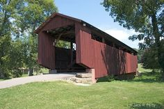 John Bright Covered Bridge LOC: on Ohio University Lancaster Branch Campus over Fetters Run, Pleasant Twp sec 30 (off OH37 2 mile N. jct US22 on E. side.) NRHP Truss Type: Suspension truss + arch Length: 75' | Built: 1881