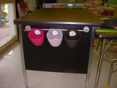 Classroom Organization: pink bucket is for sharp pencils, white is for erasers, black is for dull pencils